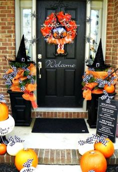 Non-scary outdoor Halloween decoations - I like the witches hat topiaries!