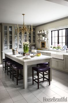 Michael Maher. A colonial kitchen in shades of neutral, Benjamin Moore's Jute on the walls and the cabinets and trim are in Farrow & Ball's Hardwick White.