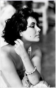 Elizabeth Taylor taking a break on the set of 'Cleopatra'.