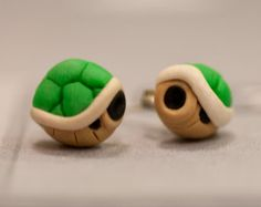 Super awesome accessory for any Mario fan! This Piranha Plant earring set made of polymer clay will sure put a bite in your day! Wear these anywhere and youre sure to get a second look! Piranha Plant earrings have the appearance of having quite the grip on the ear. Thats a scary thought but dont worry these adorable earrings will cause you no pain, maybe tears of joy though!! :)  Standard posts are not hypoallergenic. If you have sensitive ears you can add on sterling silver posts! see in…