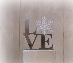 FREE Keepsake upgrade immediately! Winter Wonderland Love Snowflake Wedding Cake Topper LOVE SNOWFLAKE. Snowflake decorated in Swarovski crystals. - http://wedding-cake-topper.com/free-keepsake-upgrade-immediately-winter-wonderland-love-snowflake-wedding-cake-topper-love-snowflake-snowflake-decorated-in-swarovski-crystals/