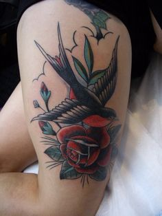 Nice color swallow tattoo with rose
