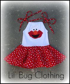 Custom Boutique Clothing Elmo Sesame Street Tiered Polka Dot Dress. $45.00, via Etsy.