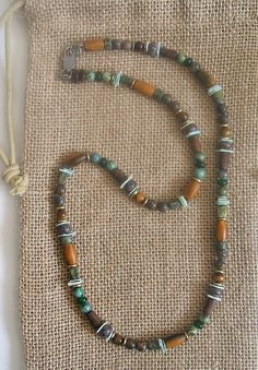 Irish seaside necklace was inspired by the colors of the Irish seaside. It is…