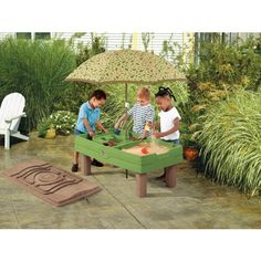 Have a ball doing it all with the Naturally Playful Sand & Water Activity Center. This activity center features wood crafted styling and nature's colors that blend with traditional landscapes in residential outdoor living areas. Water Table With Umbrella, Water Tables, Sand Table, Sand And Water Table, Water Toys, Water Play, Sand Play, Outdoor Toys, Outdoor Play