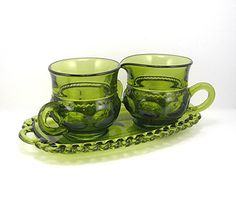 Offered is this set of glass cream and sugar on a glass tray in avocado green. Made by Indiana Glass, it is the Kings Crown Thumbprint Kings Crown, Indiana Glass, Glass Tray, Cream And Sugar, Glass Collection, Green Fashion, Teas, 3 Piece, Envy