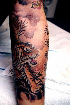 Corey Miller Tattoos - Tiger tattoo ideas. Lauren.