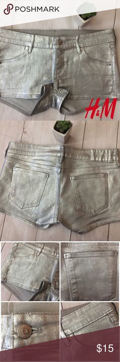 """[h&m divided] silver metallic gray jean shorts Size: 8 ( I think these run closer to a 6 as H&M sizing tends to be smaller)🔹Worn just once!🔹Divided by H&M gray jean shorts with silver metallic coating🔹2 back pockets with 2 front pockets🔹Approximate measurements: 16"""" waist, 7"""" front rise, 9"""" length🔹Made of 82% cotton 16% polyester 2% elastane (there's a little stretch to them!)🔹No rips, stains or tears and comes from smoke free home 💕Create a bundle for the best value💕 H&M Shorts Jean…"""