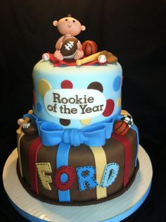 Sports Themed Baby Shower Cake - Baby and other decorations are fondant.