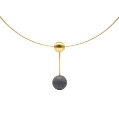 """KONZUK - A unique pendant of an 18k hand created sphere with a tinted concrete sphere suspended beneath. For a complete set, pair it with earrings kme206g. The 14k gold cable is available in sizes 16"""" and 18""""."""