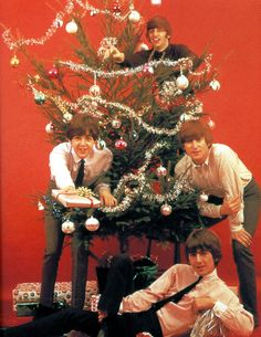 1964.The Beatles at Christmas, clockwise from left: Paul McCartney, Ringo Starr, John Lennon, and George Harrison. GAB Archive/Redferns  - TownandCountryMag.com