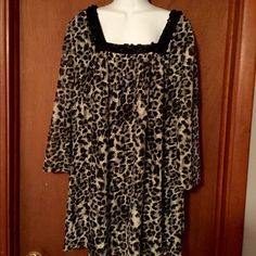 Stunning Animal Print Blouse NWT Black, gray and white Animal Print blouse. Fully lined. Square neckline embellished with black sequin. Size 1X Fashion Bug Tops Blouses