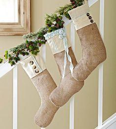 Pinecones-and-Greens Garland. Love the burlap stockings.