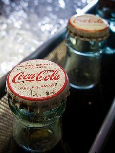 Old Coke machine in Ventura, California by Calphoto.