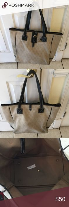 Dooney & Bourke Tote Large beige tote with black straps few stains in good condition no tears. Dooney & Bourke Bags Totes
