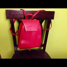 Red leather-like backpack Awesome red leather like backpack with two compartments and center zipper pouch. The straps are adjustable. The bag has been used only a couple of times. Attractive offers strongly considered!  Bags Backpacks