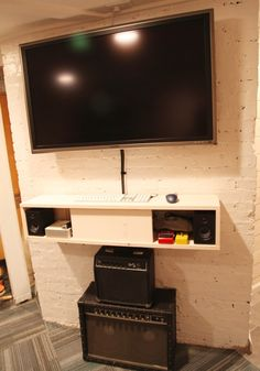 floating shelf/cupboard below tv for components