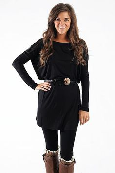 """Oh So Easy Tunic, Black $39.00 PIKO tops are here!! If you do not own one of these tops, you are missing out! We are loving the gorgeous color and super soft material. You will not find a top more comfortable than this one. Pair it with leggings and a layering tank or add jeans. Either will look amazing!!   Fits true to size. Miranda is wearing the small.   From shoulder to hem:  Small- 27""""  Medium- 28""""  Large- 29"""""""