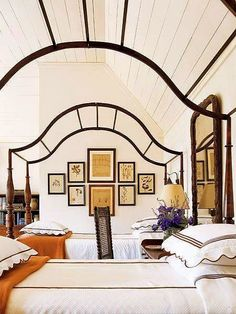 When thinking about how to hang your next art grouping, consider the lines of the focal pieces of furniture in your space – such as the lines of the beds in this image. The shape of this grouping, mimics the graceful lines of the canopy portions of these four poster beds. You could also mimic the lines of architecture, like arches in doorways or the curves of a breakfast nook… Inspiration is everywhere, you just have to look to find it!