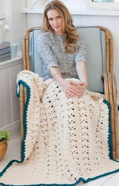 Weekend Throw Crochet Pattern  Enjoying some time to relax on the weekend is easier with this cuddly crocheted throw. We've shown it in off white with a contrasting border, but it would be just as comforting in any color you desire.