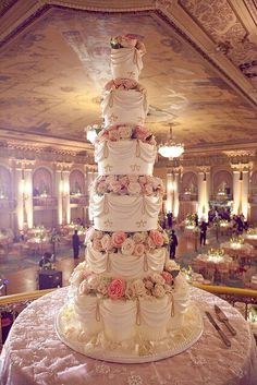 """Many, many tiered wedding cake with layers of flowers and """"rouched"""" icing"""