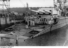 German heavy cruiser Lützow (formerly Deutschland) in the ship dock of Kiel. The ship was seriously damaged as a result of falling into its stern of torpedo from the British submarine Spearfish Ww1 Battles, Royal Navy Submarine, Heavy Cruiser, Naval, Armada, Navy Ships, Submarines, Military History, Cruises