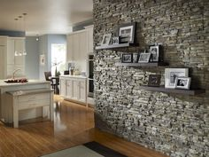 Love a stone accent wall, or stone under a kitchen island.