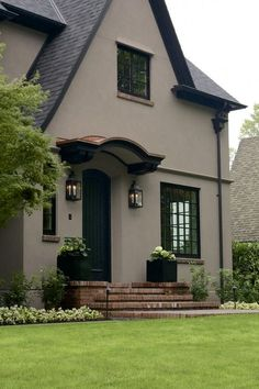 Stucco exterior Laurelhurst House Front Door - The body is color Benjamin Moore Shenandoah Taupe. Best Exterior Paint, Stucco Exterior, Stucco Homes, Exterior Paint Colors For House, Paint Colors For Home, Exterior Design, Black Trim Exterior House, Door Design, Exterior Windows