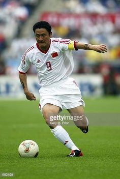 Mingyu Ma of China runs with the ball during the FIFA World Cup Finals 2002 Group C match between China and Costa Rica played at the Gwangju World...