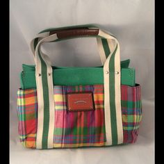 Tommy Hilfiger purse Cute purse in very good condition. Very colorful and fun. Few white tiny spots completely unnoticeable as shown in picture 3 and 2 minor stains at the bottom as shown in picture 4. Tommy Hilfiger Bags