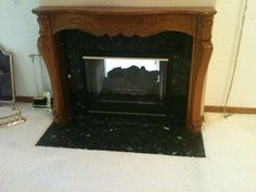 Fireplace before hardwood installation. The tile on the floor will be removed.