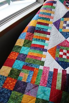 This is Lori& Diamond Dazzler quilt and it is a pattern by Glad Creations. Lori used beautiful bright coloured batiks and a tone on tone white background. She asked for custom quilting and I used a v Batik Quilts, Panel Quilts, Scrappy Quilts, Quilt Binding, Quilt Stitching, Quilt Boarders, Quilt Blocks, Scrap Quilt Patterns, String Quilts