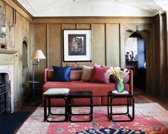In a Manhattan apartment designed by Grand Master John Saladino, 17th-century French wood paneling frames the media room/den.