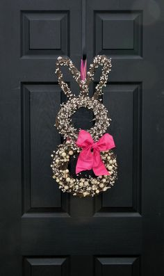 Easter bunny wreath - two round wreaths and a heart shaped one for ears #grapevine