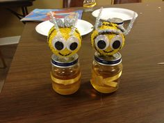 Rosh Hashanah honeybee jar craft using styrofoam balls, paint, pipe cleaners, glitter foam cut outs for wings, and recycled baby food jars. Use a hot glue gun to assemble.