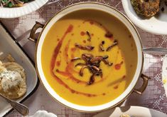 A garnish of fried mushrooms and a drizzle of spiced mint butter adds elegance to this fragrant Winter Squash and Apple Soup.