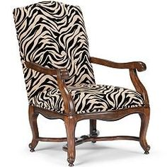 I have animal print in almost every room of my house. Whether leopard, cheetah, zebra or otherwise, it's one of my favorite ways to spice up a room. So I had to include it in my furniture collection. I designed this zebra print chair with a matching ottoman. I have both pieces in my office - it's a great place to sit and work, think, or (sometimes!) chat.