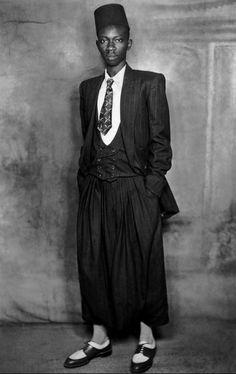 A dapper young man in Dakar, Senegal, c.1950. Photo by Mama Casset.