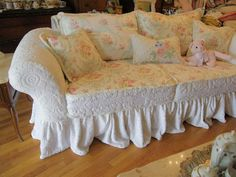 custom shabby sofa chic chenille bedspread slipcover white pink roses couch cottage prairie. $1,800.00, via Etsy.