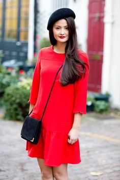 Peony Lim makes a rare red dress appearance in her Phillip Treacy beret. Hello Miss Peony.