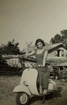 Lorella De Luca on a Vespa