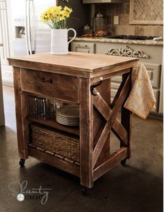 This DIY Rustic Kitchen Island will add a touch of class to your kitchen and it's so handy. You could use it as a Bar Cart too or even a mobile Potting Bench. Be sure to also view the Kitchen Rolling Table Island!