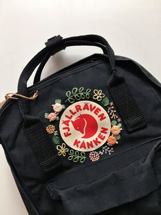 Fjallraven Kanken Embroidery Backpack Customizable Fjallraven Kanken Hand Embroidery Backpack You can choose your favorite color from the Fjallraven Kanken website! The colours in stock may vary from time to time. Mochila Jansport, Mochila Kanken, Guess Backpack, Backpack Outfit, Diaper Bag Backpack, Laptop Backpack, Backpack Storage, Prada Backpack, Yellow Backpack