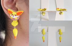 handmade Fennekin pokemon earrings out of polymer clay. no paints. this is a one of a kind pair and it is not heavy. The earrings is just like any other dangling earrings and they are easy to wear....
