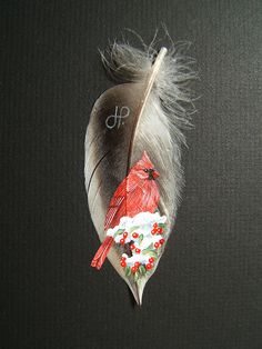 Cardinal painted on feather