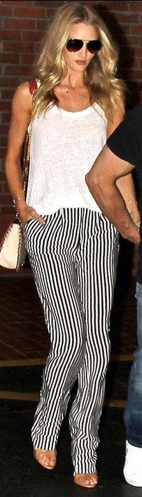 Rosie Huntington-Whiteley: Sunglasses- Burberry  Purse – Emilio Pucci  Shoes – Brian Atwoo