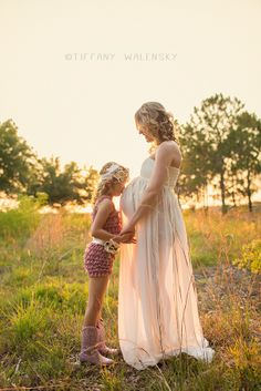 what to wear, mama and big sister sibling. sheer white gown dress. maternity pregnancy pregnant expecting photographer photography session ideas posing sunset field