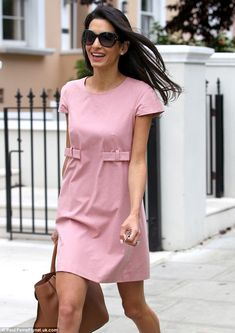 Pretty in pink: Amal Alamuddin looked gorgeous in her loose fit pink dress as she headed out to lunch on Tuesday