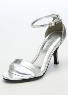 ef1460099afaa8 Slim ankle strap sandal with exposed vamp and buckle closure. Heel height   Available in Gold   Silver. Also available in dyeable White. About Dyeable  Shoes.
