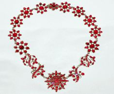 18th C. Rococo Flat-cut Garnet Necklace Ca 1760 - vibrant almandine garnets foiled cherry-red and set in silver closed- back settings. The necklace consists of foliate and floral cluster panels with a central stylized flowerburst. In wonderful bright condition